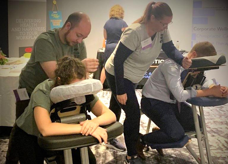 Alexander & Brionna Providing Chair Massage